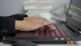 Close-up of hands typing on a laptop keyboard. Close-up of hands typing on laptop keyboard stock footage