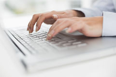 Close up of hands typing on laptop keyboard royalty free stock photo