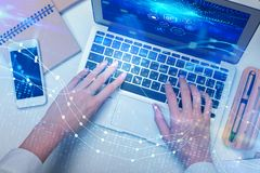 Economy and innovation concept. Close up of hands using laptop with abstract digital business chart. Economy and innovation concept. Double exposure stock photo