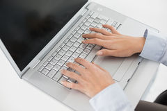 Close up of hands using laptop Royalty Free Stock Photo
