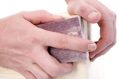 Close Up Of Hands Using Sanding Pad Stock Photos