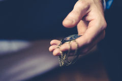 Close up of hands with vintage pocket watch Stock Image