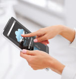 Close up of hands with weather cast on tablet pc Stock Photos
