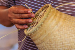 Close up hands weaving bamboo steamer in northeastern village of Stock Image