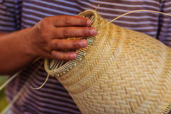 Close up hands weaving bamboo steamer in northeastern village of Royalty Free Stock Image