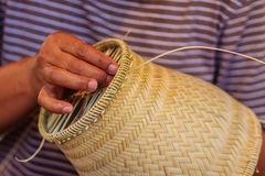 Close up hands weaving bamboo steamer in northeastern village of Stock Images