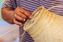 Close up hands weaving bamboo steamer in northeastern village of Royalty Free Stock Photo