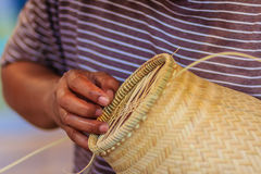 Close up hands weaving bamboo steamer in northeastern village of Royalty Free Stock Photography