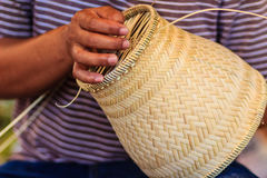 Close up hands weaving bamboo steamer in northeastern village of Stock Photo