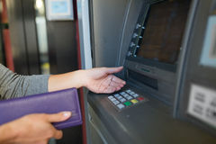 Close up of hands withdrawing cash at atm machine Stock Images