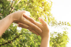Close up of hands of woman exercising in sunlight. Close up of woman hands exercising in sunlight. Deep breath fresh air in the park Stock Photo