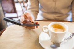 Close up of hands woman using her cell phone in restaurant,cafe Royalty Free Stock Photos