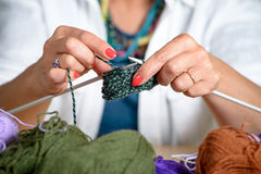Close up of the hands of a woman who knits Stock Images