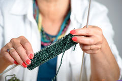 Close up of the hands of a woman who knits Stock Image