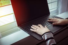Close up hands woman working using laptop and connecting wifi Stock Photo