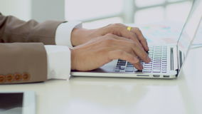 Close up hands working on laptop keyboard. Close up businessman typing on laptop keyboard, smooth moving scene stock video footage
