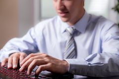 Close-up hands of a young man  working on the computer. Stock Photo