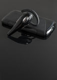 Close-up of handsfree bluetooth device. Royalty Free Stock Images