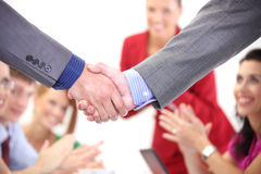 Close up: Handshake. Closeup: Business men shaking hands over a deal Royalty Free Stock Images