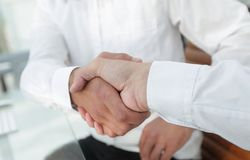 Close-up handshake of business colleagues. Royalty Free Stock Images