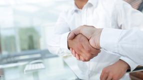 Close-up handshake of business colleagues. Stock Photos
