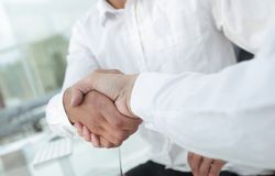 Close-up handshake of business colleagues. The concept of partnership Royalty Free Stock Photos