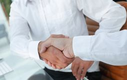 Close-up handshake of business colleagues. Stock Image