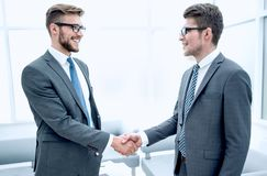 Close up.handshake business people in a modern office royalty free stock photos
