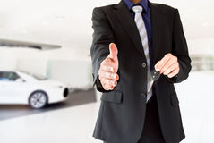 Close up of a handshake from a dealership Stock Photography