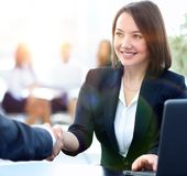Close-up of a handshake of a Manager and customer in the workpla. Ce.photo with copy space Royalty Free Stock Photos