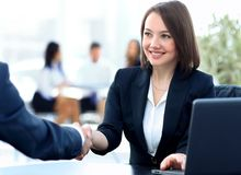 Close-up of a handshake of a Manager and customer in the workplace. Stock Photography