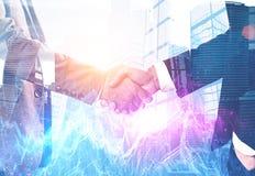 Close up of handshake near skyscrapers, graphs stock photos