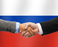 Close up of handshake over russian flag Stock Images