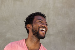 Close up handsome african american man laughing Stock Image