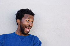 Close up handsome african american in shock by white wall Royalty Free Stock Photo