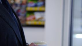 Close up of a handsome businessman drinking tea or coffe. Close up of a handsome businessman drinking tea or cofe stock video