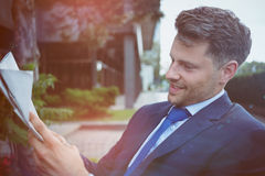 Close up of handsome businessman reading newspaper Royalty Free Stock Photography