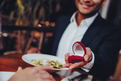 Close Up Handsome Man Proposing to Girlfriend stock photography