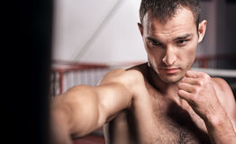Close up of handsome man punching bag Stock Photo
