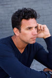 Close up handsome man sitting and thinking Stock Photo