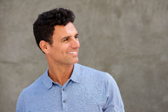 Close up handsome man smiling and looking to side. Close up portrait of handsome man smiling and looking to side Royalty Free Stock Photos