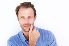 Close up handsome man thinking with hand on chin Royalty Free Stock Photo