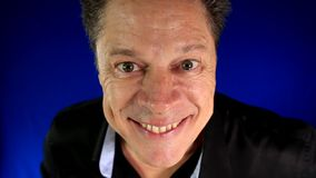 Top of attractive mature man smiling, portrait. Close up of a handsome man, touching and pointing the camera, happy and smiling