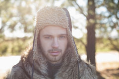 Close up of a handsome man in warm clothing in forest Royalty Free Stock Photos