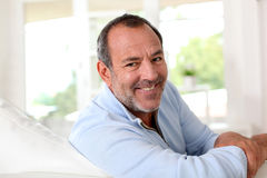 Close-up of handsome senior man smiling at home Stock Image