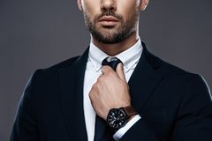 Close-up handsome and successful man in an expensive suit. He is in a white shirt with a tie. royalty free stock images