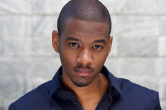 Close up handsome young black man staring Royalty Free Stock Photography
