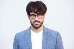 Close up handsome young man with beard and glasses against white background. Close up portrait handsome young man with beard and glasses against white background Stock Images