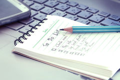 Close up Handwritten to do list plan in small note book Royalty Free Stock Image