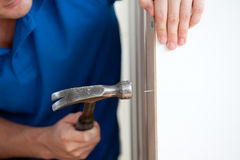 Close-up of a handyman building furniture. Using a hammer and a nail at home Royalty Free Stock Photos